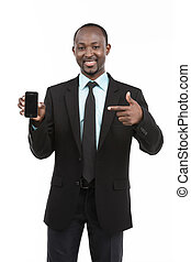 African Businessman in suit holding phone on white...
