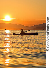 Kayaking in Montenegro - Summer sunset kayaking in...