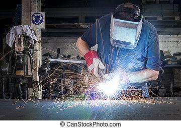 Metal Welding - Metal welding in steel workshop with sparks...