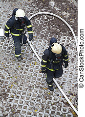 Two firefighters rush to rescue - Professional firefighters...
