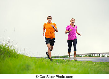Fitness sport couple running jogging outside - Fitness sport...