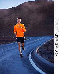 Athletic man running outside, training outdoors. Jogging on...
