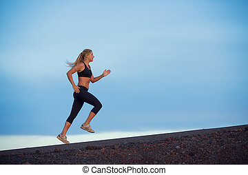 Athletic woman running jogging outside