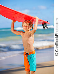 happy young boy at the beach with surfboard - Young surfer,...