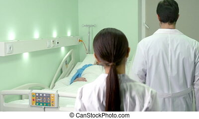 Visiting patient - Doctor and nurse visiting their senior...