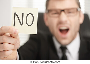 I say NO - businessman holding stick with NO