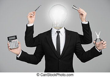Multitasking light bulb businessman