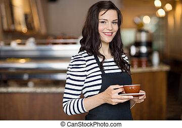 hermoso, camarera, tenencia, café, taza, en,...