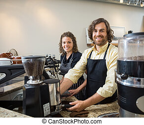 Colleagues Working In Coffeeshop - Portrait of happy...