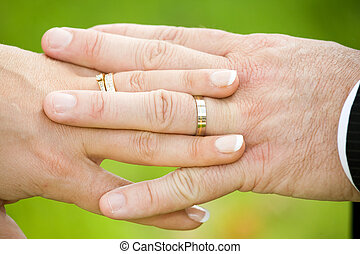 wedding hands - man and woman hands with wedding rings