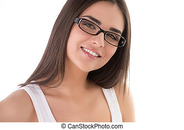 Beauty in glasses. Portrait of young women smiling while...