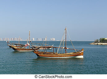 Small dhows and Pearl development - A group of small,...