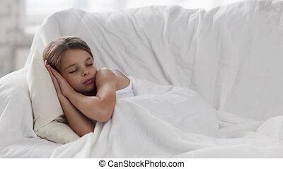 pre-teen girl sleeping at home - health, sleep and beauty,...