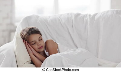 pre-teen girl sleeping at home - health, sleep and beauty,...