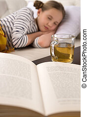 Cute girl sleeping. Little girl sleeping with the book and...