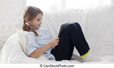 little student girl with tablet pc at home