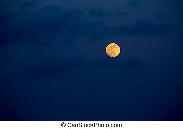 Dark blue sky with full moon and clouds - Dark blue sky with...