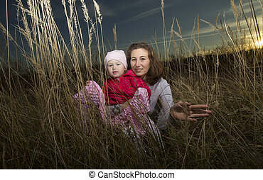 mother and child - Evening portrait of mother with baby on...