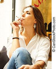 Smoking woman - Beautiful woman smoking in a cafe