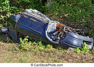 Car wreck abandoned - Wrecked car abandoned overturned in...