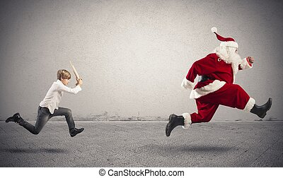 Angry child with Santa Claus for a gift wrong