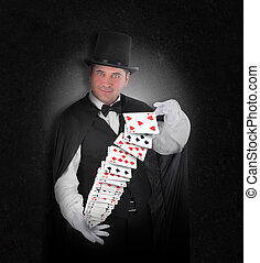 Magician with Trick Cards on Black - A magician has playing...
