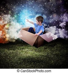Space Boy in Box Touching Glowing Star - A young boy is...