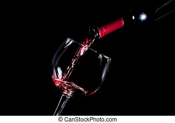 pouring red wine glass black background - pouring red wine...