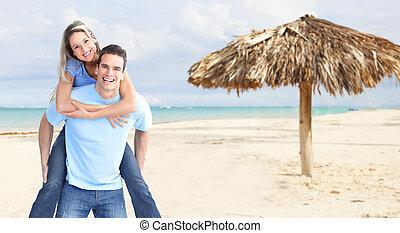 Happy couple on Punta Cana beach. Vacation.
