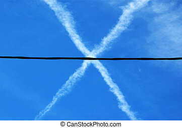 X airplane trail in the sky