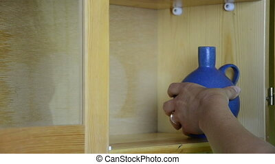 clay vases shelf - hand puts on wooden shelf a nice round...