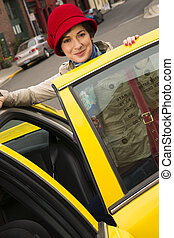Woman Smiling Wearing Bright Accents Enters Taxi Cab...