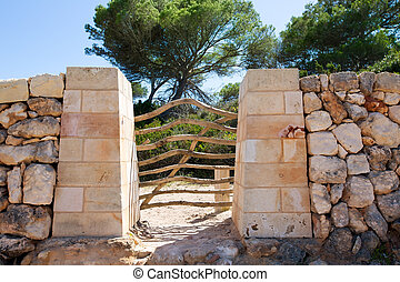 Menorca traditional wooden fence gate in Balearic islands of...