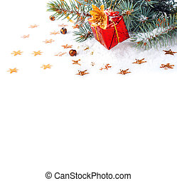 Christmas tree branch with a gift in a red box on a white background isolated