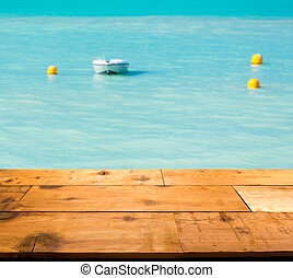 Warm turquoise ocean in caribbean by wooden decking