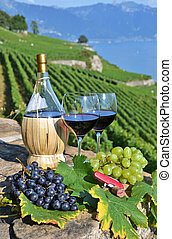 Red wine and grapes Terrace vineyards in Lavaux region,...