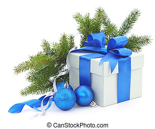 Christmas gift box with blue ribbon and fir branches