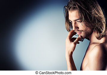 sensual - Portrait of a sexual muscular nude man posing over...