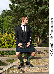 Scotsman in full dress kilt wear - A young Scotsman in full...
