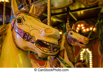 Merry Go Round - Carousel Horses on a carnival Merry Go...