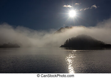 Low fog over island - Picture of a seascape with low fog and...