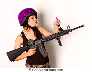 girl with cosmetics brush - beautiful armed girl in pink...