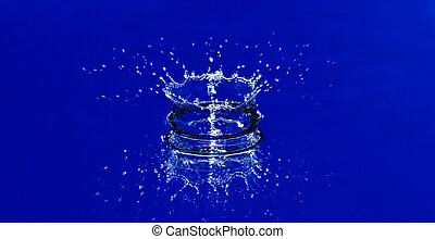 water splash - beautiful corona from splash of blue water