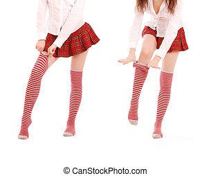 female legs in striped golfs - beautiful female legs in...