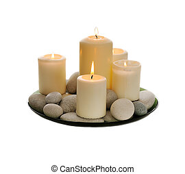 white candles - white burn candles and pebbles isolated on...