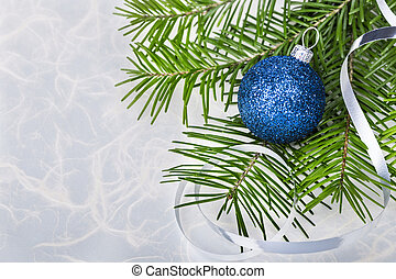 Christmas ball with fir-tree branches on abstract background...