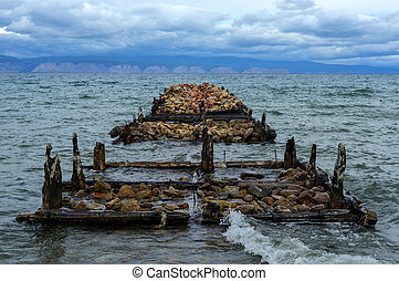 Old Pier of on Olkhon Island, Baikal, Siberia, Russia on a...