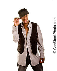 Young Black Man Holding Hat Brim - Young black man dressed...