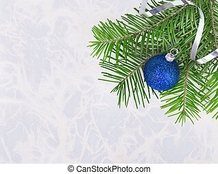 Christmas ball with fir-tree twigs on abstract background