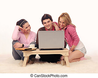 Friends with laptop.